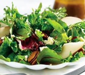 Mixed Greens and Fruit Salad with Warm Onion Vinaigrette image