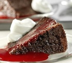 Triple Chocolate Pudding Cake with Raspberry Sauce image